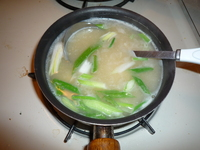 Green onion and tofu Miso soup-onions in first